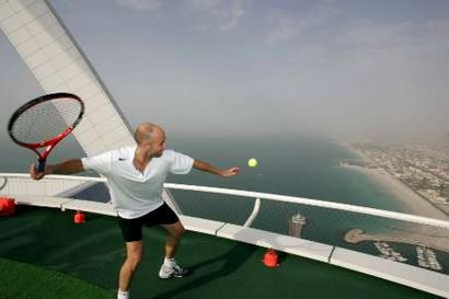 Tennis Player Andre Agassi Of The USA Hits A Ball Out To Sea From Helipad 7 Star Burj Al Arab Hotel During Publicity Shoot In Dubai