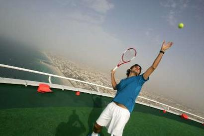 Roger Federer Of Switzerland Serves To American Andre Agassi On Top The Helipad 7 Star Burj Al Arab Hotel For A Publicity Shoot In Dubai
