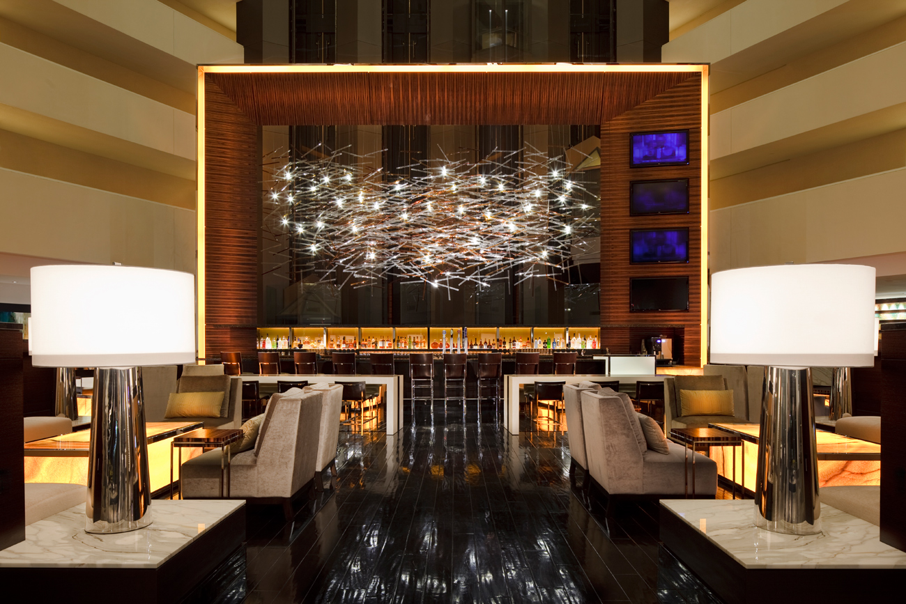 Hilton hotels resorts introduces new lobby design for Business hotel design